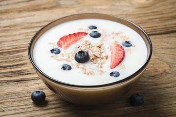 Muesli with yoghurt and fresh berries strawberry blueberry