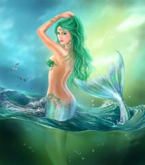 Fantasy beautiful mermaid at ocean on waves