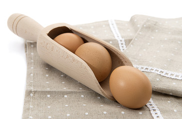 Organic eggs is wooden spoon isolated on white
