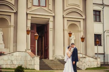 Wedding couple near old building