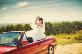 Runaway bride. Beautiful woman on red cabriolet poster