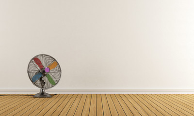 Empty room with colorful fan