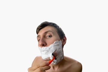 Fun fisheye view of young man who has shave on white background
