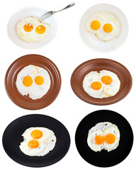 set from two fried eggs on plates isolated