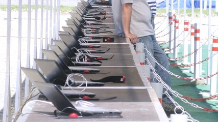 Laptops stand on tables before competitions on firing on pentathlon, time lapse