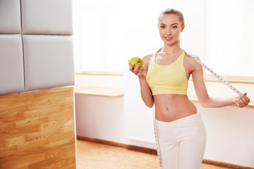 Diet. Healthy Food. Beautiful Young Woman with Apple