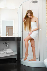 Long Woman Legs. Beautiful Woman Cares About Legs After Shower