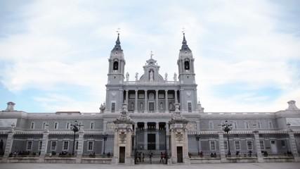 People walk near Cathedral of Nuestra Senora de la Almudena