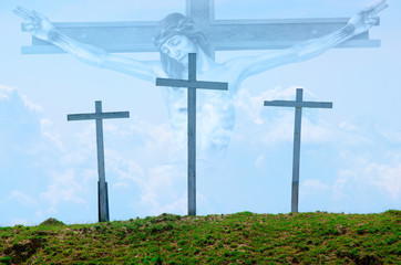 Three wooden crosses with Jesus in background