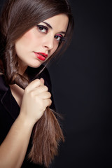 Beautiful woman with long brown straight hairs and red nails lyi