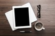 Pad. Tablet with blank white screen and coffee cup on office