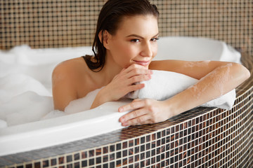 Beautiful Woman Takes Bubble Bath.