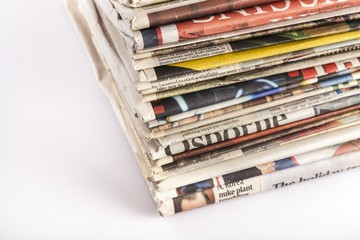 Advertise. Stack of international newspapers