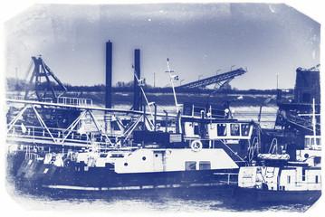 Ships moored at a shipyard