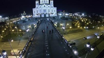 People walk by Patriarshy bridge to Christ the Saviour Cathedral