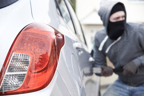 Poster Masked Man Breaking Into Car With Crowbar