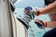 Leinwandbild Motiv Winch and sailors hands on a sailboat