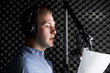 Man In Recording Studio Talking Into Microphone - 80154094