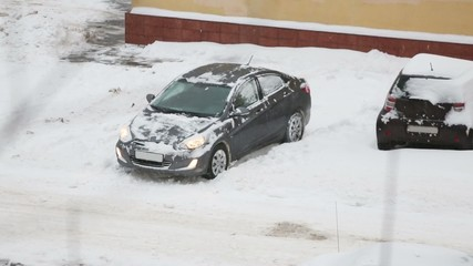 car skidding in snow at winter snowy day. Above view