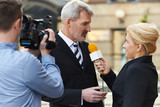 Female Journalist With Microphone Interviewing Businessman - 80155015