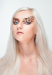 Portrait of a young beautiful woman with creative makeup