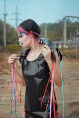 Futuristic girl in black PVC dress