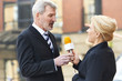 Female Journalist With Microphone Interviewing Businessman - 80155226