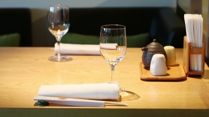 Table with glasses in cafe with modern cozy interior