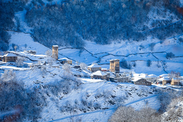 Mountain village on the snowy slope in Caucasus