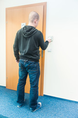 man puts the card into the reader access control