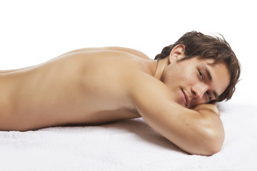 Sexy Young man relaxing in spa