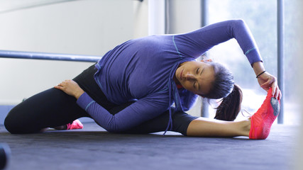 Flexible woman stretching