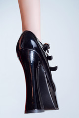 Black leather high-heel shoe