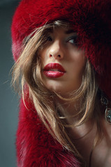 Young woman in red fur hat