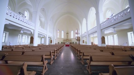 Rows of benches and Sanctuary in Evangelical Lutheran Cathedral