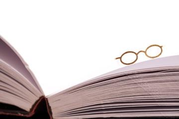 Reading glasses on book edge