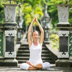 woman meditating doing yoga