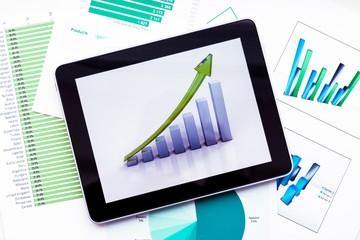 Finance. Modern working desk with digital tablet