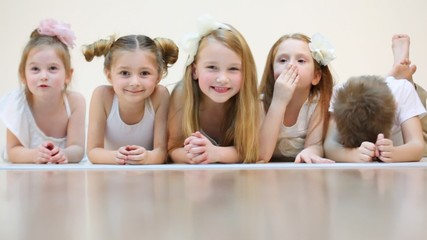 Five cute children sitting, talking and smiling isolated