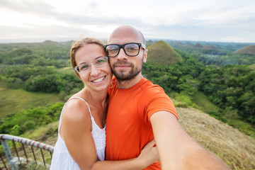Happy couple at the chocolate hills in Bohol