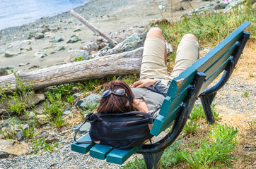 Woman Hiker Resting on a Bench