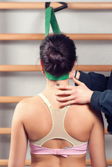 Woman Stretching Neck with Teacher