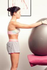 Girl Exercising with Gym Ball