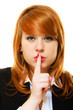 Girl with  finger on lips hush hand gesture