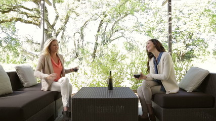 Girlfriends enjoying a drink at a luxury resort in wine country