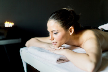 Young and beautiful lady relaxing on a massage table