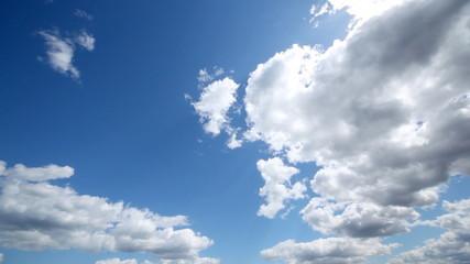 circular panorama of dark blue sky of plumose white clouds on it
