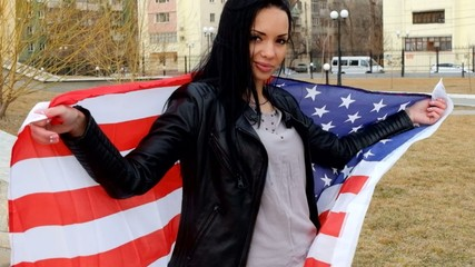Latino women posing with US flag outdoors