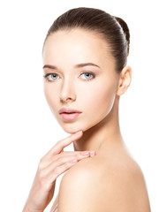 Young woman with healthy clean skin touches the face. Skin care