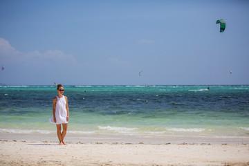 Caucasian woman rests at beautiful seashore
